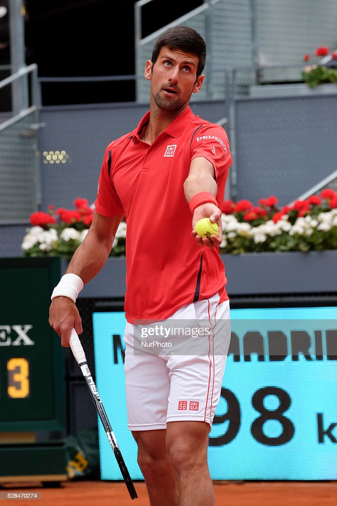 <a gi-track='captionPersonalityLinkClicked' href=/galleries/search?phrase=Novak+Djokovic&family=editorial&specificpeople=588315 ng-click='$event.stopPropagation()'>Novak Djokovic</a> of Serbia against Roberto Bautista Agut of Spain in their third round match during day six of the Mutua Madrid Open tennis tournament at the Caja Magica on May 05, 2016.