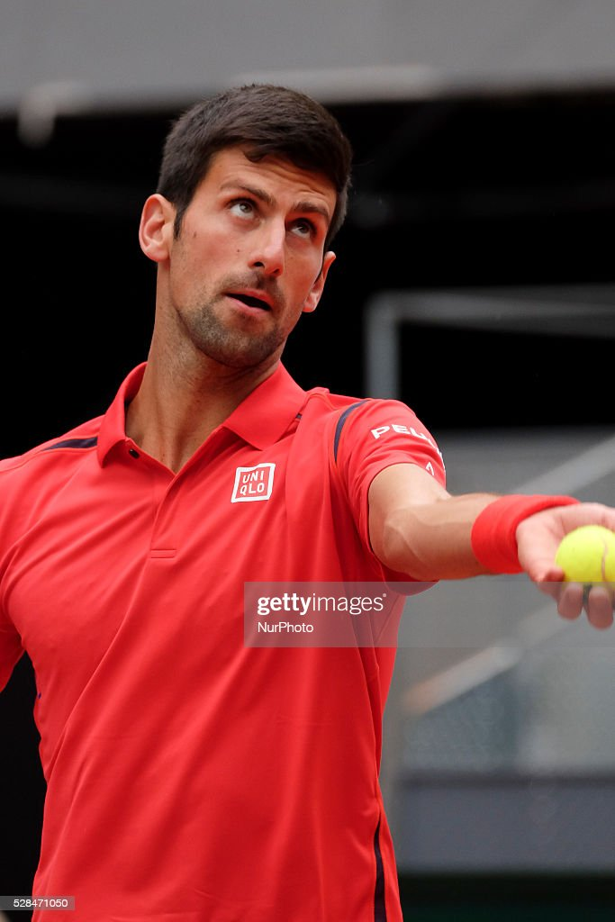 Novak Djokovic of Serbia against Roberto Bautista Agut of Spain in their third round match during day six of the Mutua Madrid Open tennis tournament at the Caja Magica on May 05, 2016.