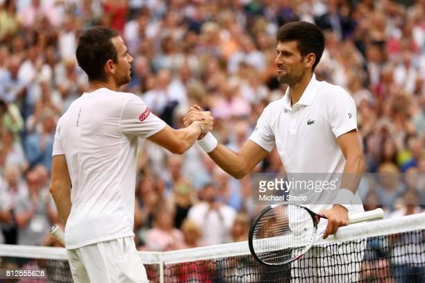 Novak Djokovic of Serbia and Adrian Mannarino of France shake hands after the Gentlemen's Singles fourth round match against on day eight of the...