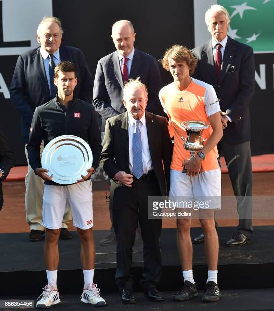 Novak Djokovic of Serbia and Alexander Zverev of Germany poses with Rod Laverof Australia and the trophy after winning the ATP Singles Final match...