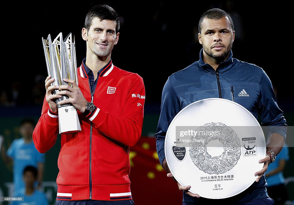 Novak Djokovic of Serbia and Jo-Wilfried Tsonga of France pose with their trophies after their men's singles final match of the Shanghai Rolex Masters at the Qi Zhong Tennis Center on day 8 of Shanghai Rolex Masters at Qi Zhong Tennis Centre on October 18, 2015 in Shanghai, China.