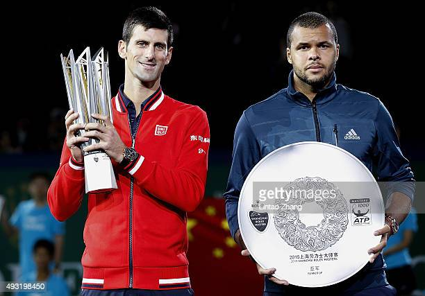 Novak Djokovic of Serbia and JoWilfried Tsonga of France pose with their trophies after their men's singles final match of the Shanghai Rolex Masters...
