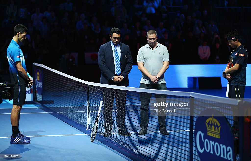 Novak Djokovic (L) of Serbia and Kei Nishikori of Japan observe a minute's silence to remember those who lost their lives in the recent Paris attacks prior to their men's singles match during day one of the Barclays ATP World Tour Finals at O2 Arena on November 15, 2015 in London, England.