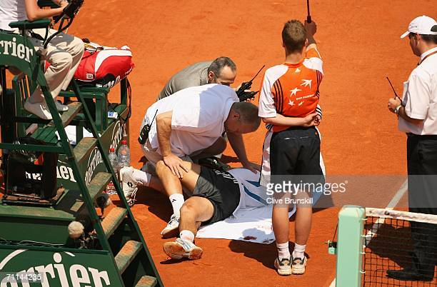 Novak Djokovic of Serbia and Montenegro receives treatment against Rafael Nadal of Spain during day eleven of the French Open at Roland Garros on...