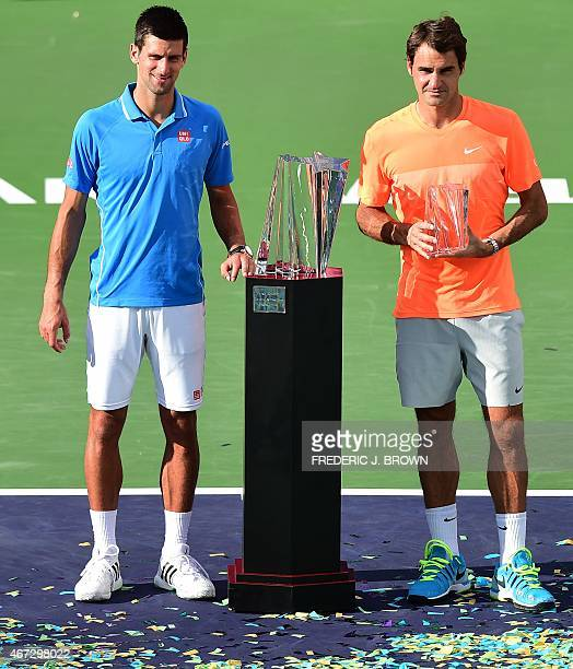 Novak Djokovic of Serbia and Roger Federer of Switzerland pose during the trophy presentation following the men's final of the BNP Paribas Tennis...