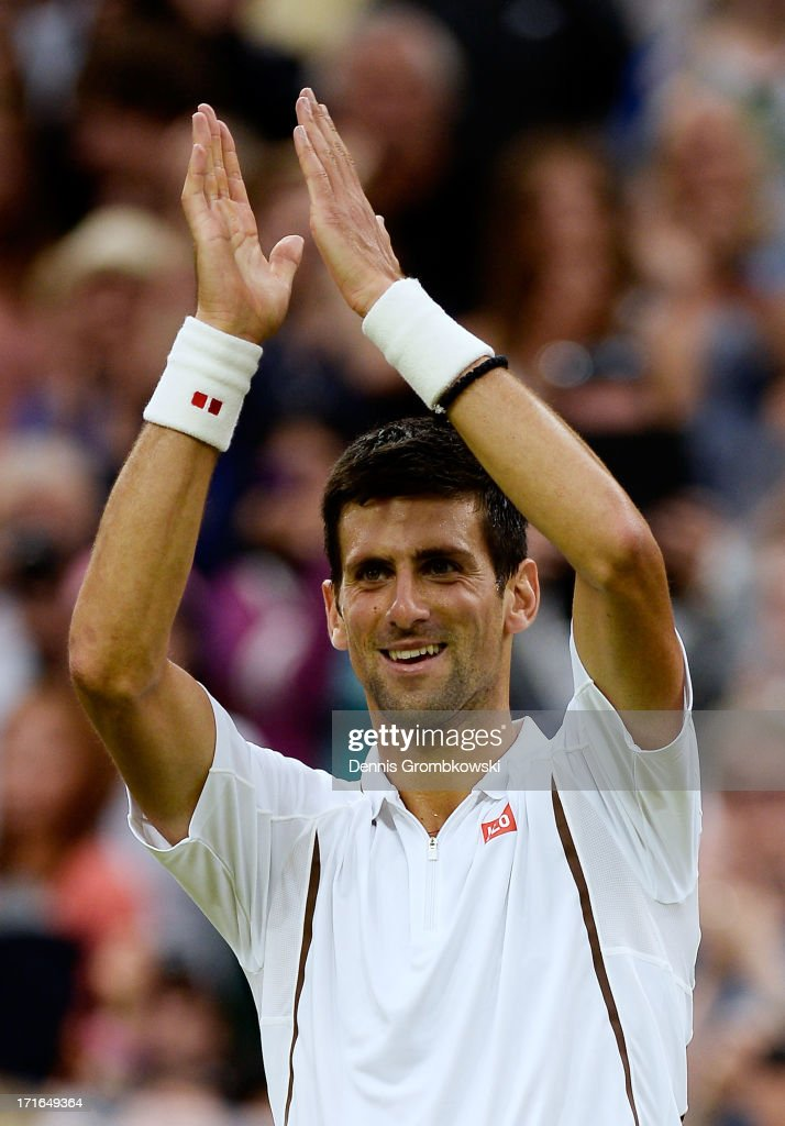 Novak Djokovic of Serbia applauds the crowd as he celebrates match point during his Gentlemen's Singles second round match against Bobby Reynolds of the United States of America on day four of the Wimbledon Lawn Tennis Championships at the All England Lawn Tennis and Croquet Club on June 27, 2013 in London, England.