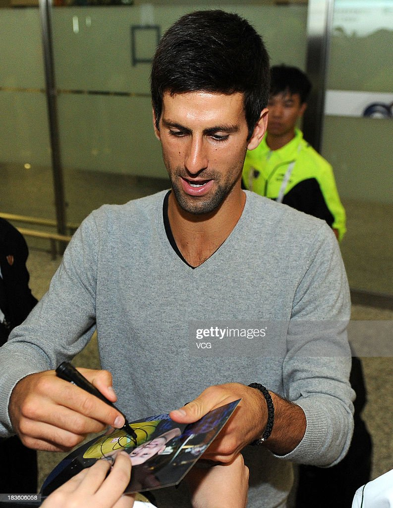 <a gi-track='captionPersonalityLinkClicked' href=/galleries/search?phrase=Novak+Djokovic&family=editorial&specificpeople=588315 ng-click='$event.stopPropagation()'>Novak Djokovic</a> of Serbia arrives at Hongqiao Airport on day one of the Shanghai Rolex Masters on October 7, 2013 in Shanghai, China.
