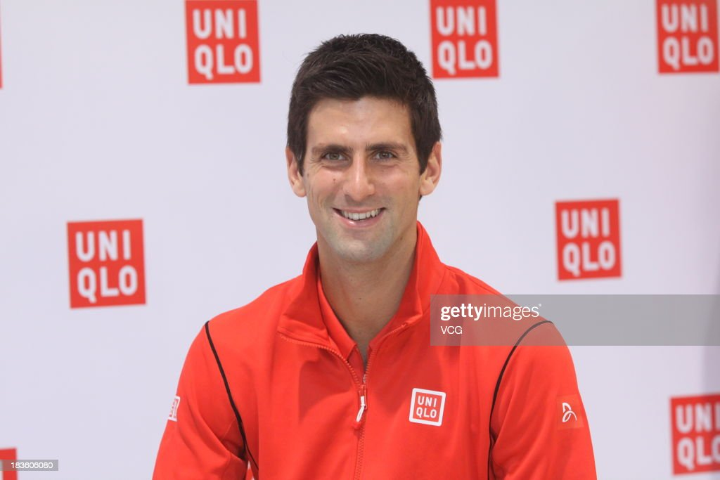 <a gi-track='captionPersonalityLinkClicked' href=/galleries/search?phrase=Novak+Djokovic&family=editorial&specificpeople=588315 ng-click='$event.stopPropagation()'>Novak Djokovic</a> of Serbia attends Uniqlo promotional event at Uniqlo Shanghai Global Flagship store on day one of the Shanghai Rolex Masters on October 7, 2013 in Shanghai, China.