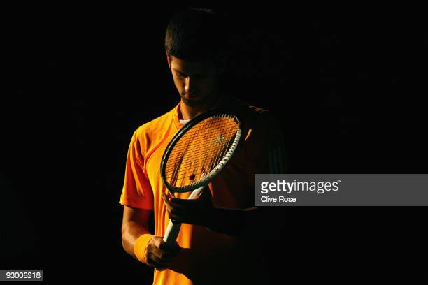 Novak Djokovic of Serbia awaits in the dark to start his match against Arnaud Clement of France during the ATP Masters Series at the Palais...