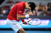 Novak Djokovic of Serbia celebrates a ball against Rafael Nadal of Spain during the Men's Single Final on night day of the China Open at the China...