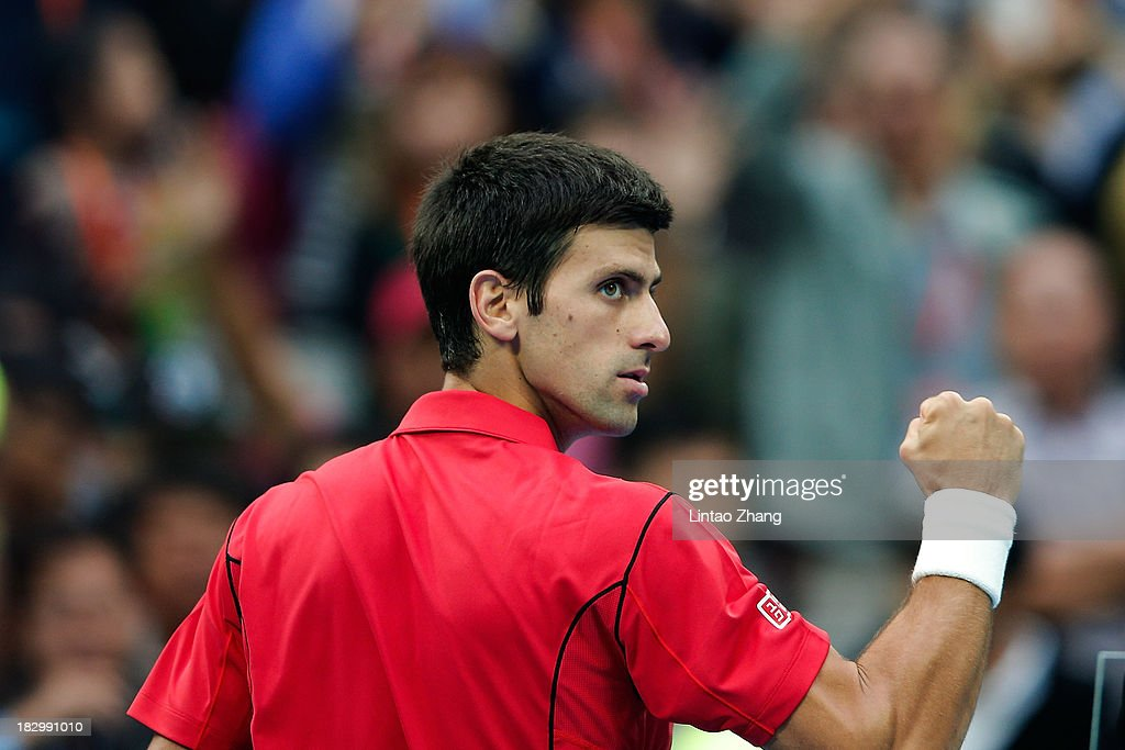 <a gi-track='captionPersonalityLinkClicked' href=/galleries/search?phrase=Novak+Djokovic&family=editorial&specificpeople=588315 ng-click='$event.stopPropagation()'>Novak Djokovic</a> of Serbia celebrates a ball during his men's singles match against Fernando Verdasco of Spain on day six of the 2013 China Open at the National Tennis Center on October 3, 2013 in Beijing, China.
