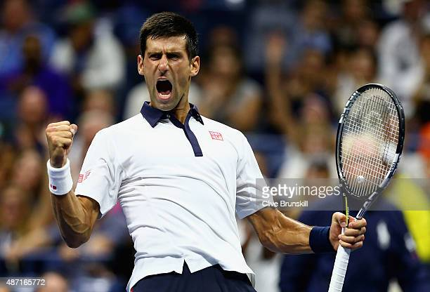 Novak Djokovic of Serbia celebrates a break of serve in the fourth set against Roberto Bautista Agut of Spain in their mens singles fourth round...