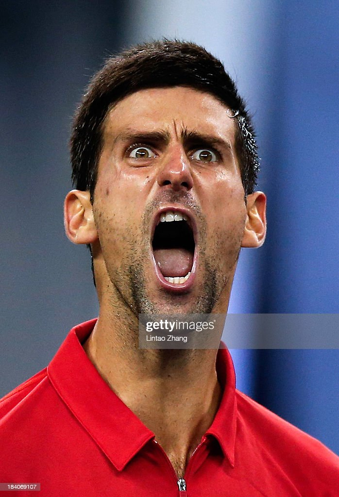 <a gi-track='captionPersonalityLinkClicked' href=/galleries/search?phrase=Novak+Djokovic&family=editorial&specificpeople=588315 ng-click='$event.stopPropagation()'>Novak Djokovic</a> of Serbia celebrates a point against Gael Monfils of France during day five of the Shanghai Rolex Masters at the Qi Zhong Tennis Center on October 11, 2013 in Shanghai, China.