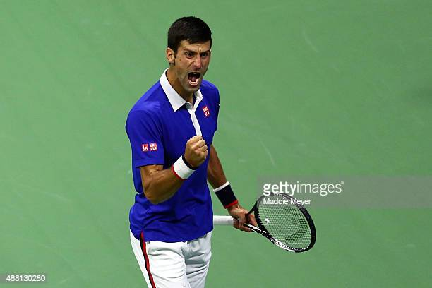 Novak Djokovic of Serbia celebrates a point against Roger Federer of Switzerland during their Men's Singles Final match on Day Fourteen of the 2015...