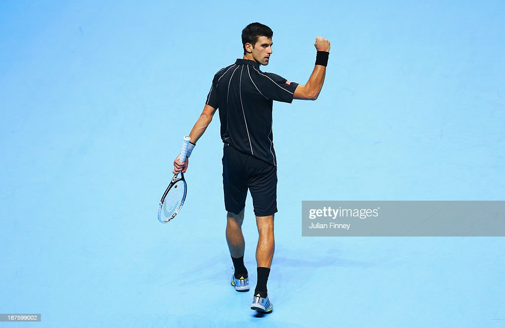 Novak Djokovic of Serbia celebrates a point in his men's singles semi-final match against Stanislas Wawrinka of Switzerland during day seven of the Barclays ATP World Tour Finals at O2 Arena on November 10, 2013 in London, England.