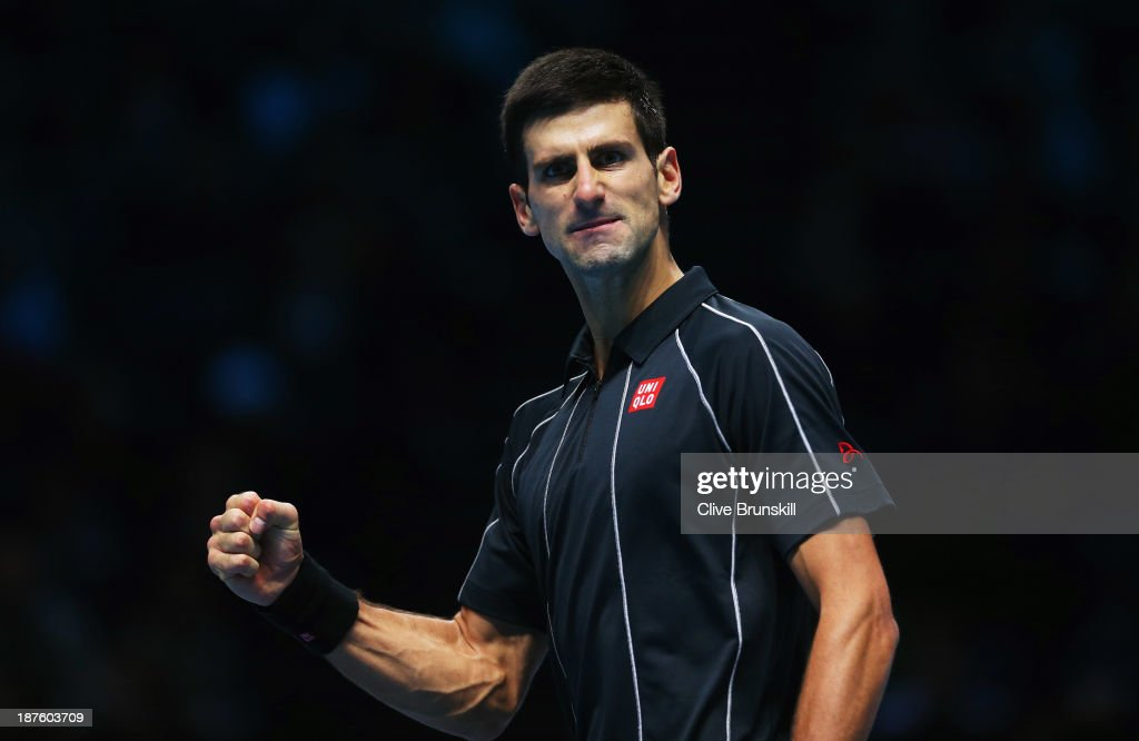 <a gi-track='captionPersonalityLinkClicked' href=/galleries/search?phrase=Novak+Djokovic&family=editorial&specificpeople=588315 ng-click='$event.stopPropagation()'>Novak Djokovic</a> of Serbia celebrates a point in his men's singles semi-final match against <a gi-track='captionPersonalityLinkClicked' href=/galleries/search?phrase=Stanislas+Wawrinka&family=editorial&specificpeople=557155 ng-click='$event.stopPropagation()'>Stanislas Wawrinka</a> of Switzerland during day seven of the Barclays ATP World Tour Finals at O2 Arena on November 10, 2013 in London, England.