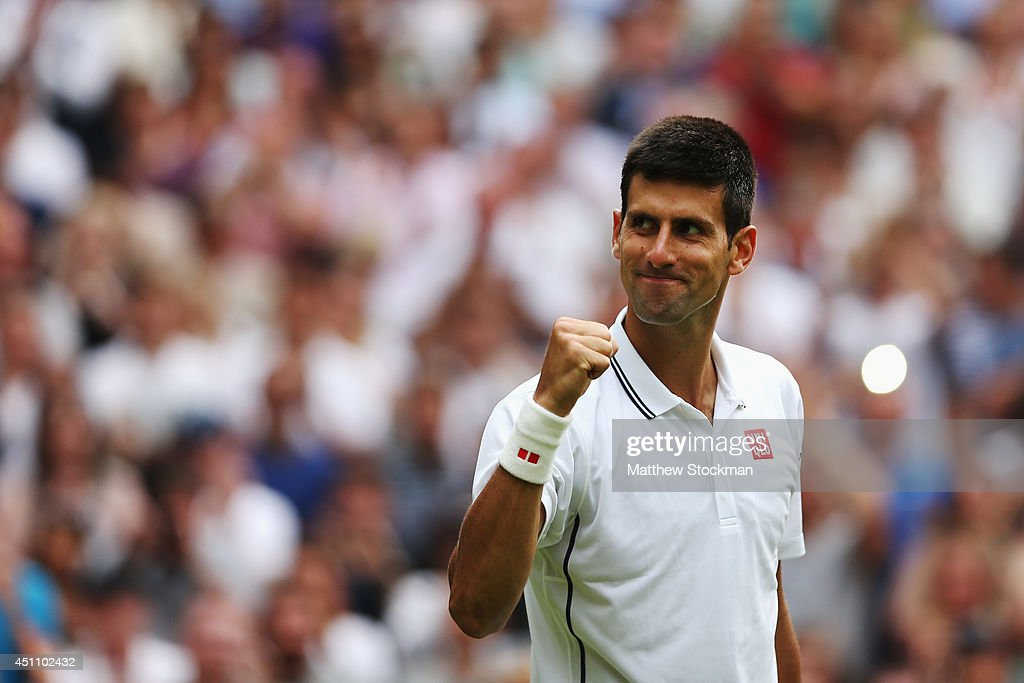 Novak Djokovic of Serbia celebrates after defeating Andrey Golubev of Kazakhstan in three straight sets during their Gentlemen's Singles first round match on day one of the Wimbledon Lawn Tennis Championships at the All England Lawn Tennis and Croquet Club at Wimbledon on June 23, 2014 in London, England.