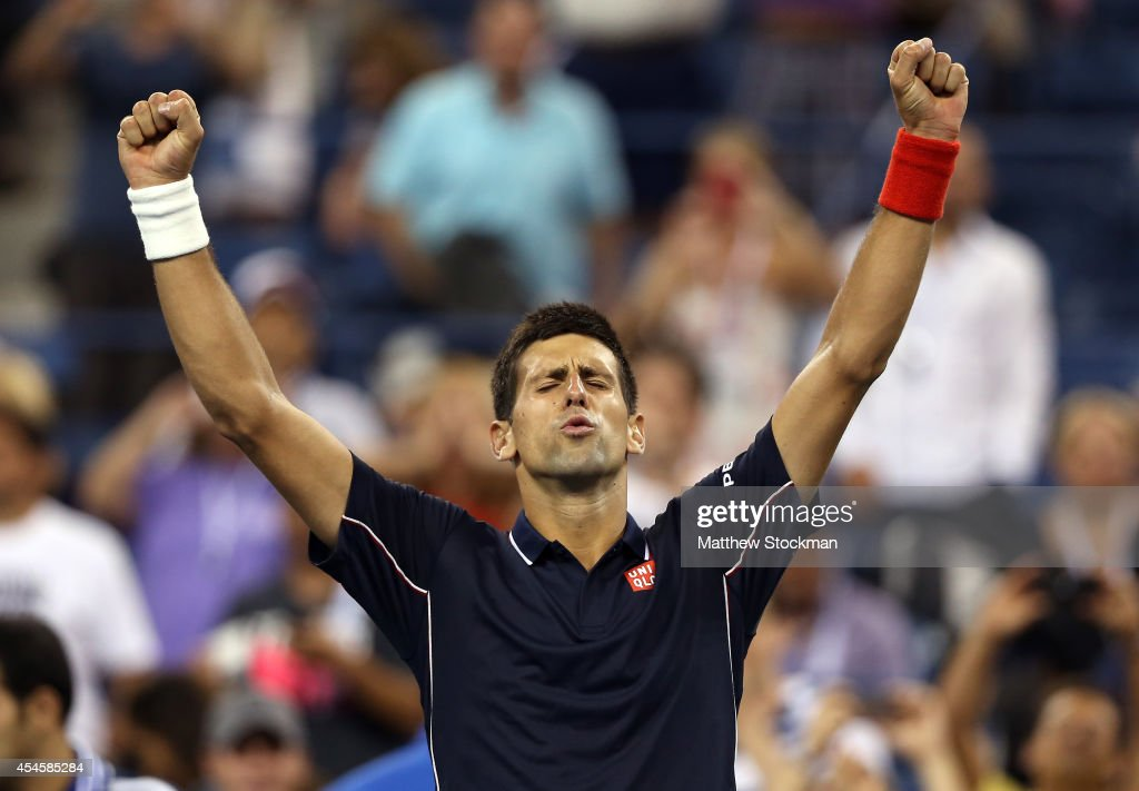<a gi-track='captionPersonalityLinkClicked' href=/galleries/search?phrase=Novak+Djokovic&family=editorial&specificpeople=588315 ng-click='$event.stopPropagation()'>Novak Djokovic</a> of Serbia celebrates after defeating Andy Murray of Great Britain in their men's singles quarterfinal match on Day Ten of the 2014 US Open at the USTA Billie Jean King National Tennis Center on September 3, 2014 in the Flushing neighborhood of the Queens borough of New York City. Djokovic defeated Murray 7-6, 6-7, 6-2, 6-4.