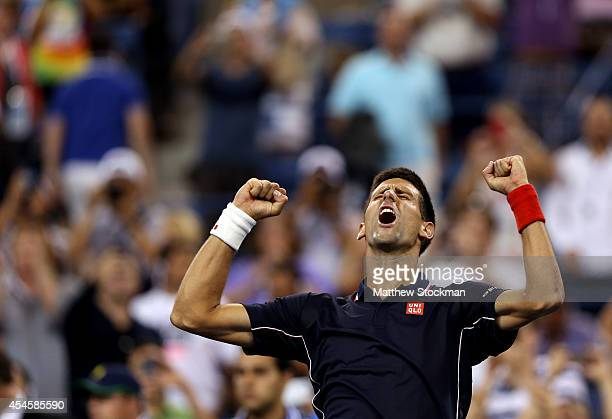 Novak Djokovic of Serbia celebrates after defeating Andy Murray of Great Britain in their men's singles quarterfinal match on Day Ten of the 2014 US...