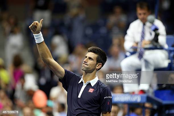Novak Djokovic of Serbia celebrates after defeating Feliciano Lopez of Spain during their Men's Singles Quarterfinals match on Day Nine of the 2015...