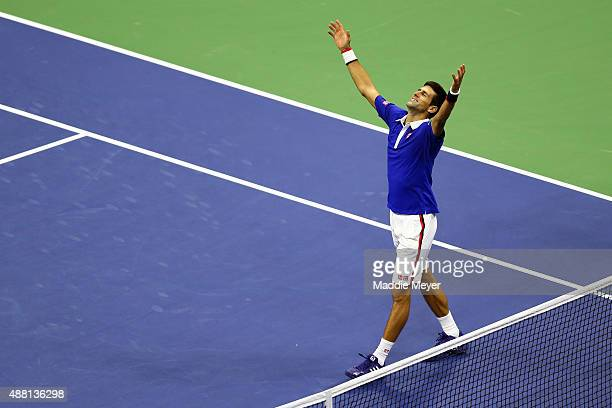 Novak Djokovic of Serbia celebrates after defeating Roger Federer of Switzerland during their Men's Singles Final match on Day Fourteen of the 2015...