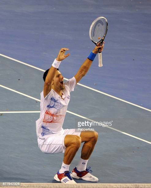 Novak Djokovic of Serbia celebrates after winning a five set Semi Final against Andy Murray of Great Britain during day twelve of the 2012 Australian...