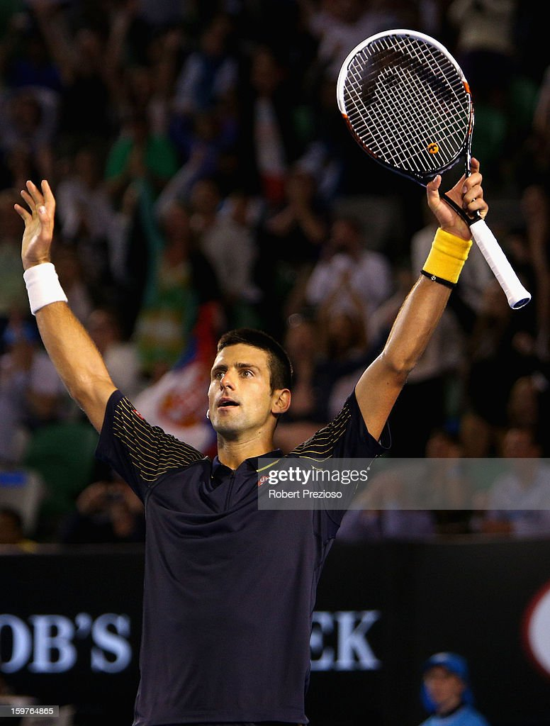 <a gi-track='captionPersonalityLinkClicked' href=/galleries/search?phrase=Novak+Djokovic&family=editorial&specificpeople=588315 ng-click='$event.stopPropagation()'>Novak Djokovic</a> of Serbia celebrates after winning his fourth round match against Stanislas Wawrinka of Switzerland during day seven of the 2013 Australian Open at Melbourne Park on January 20, 2013 in Melbourne, Australia.