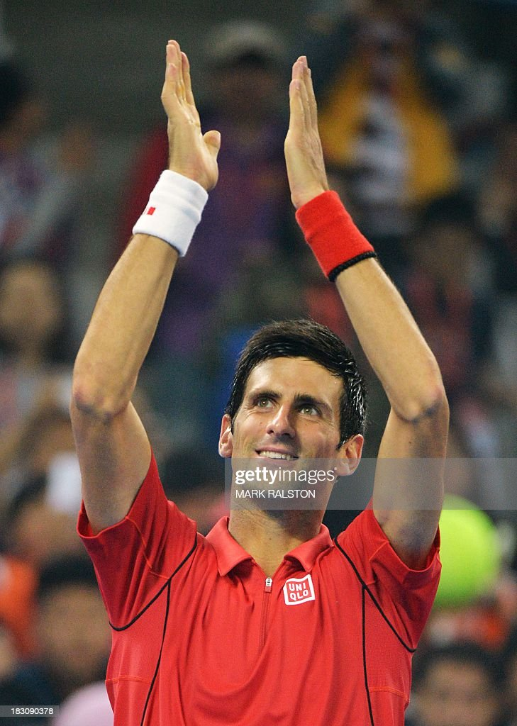 Novak Djokovic of Serbia celebrates after winning his men's singles quarterfinals match against Sam Querrey of USA at the China Open tennis tournament in Beijing on October 4, 2013. Djokovic went on to win 6-1, 6-2. AFP PHOTO / Mark RALSTON