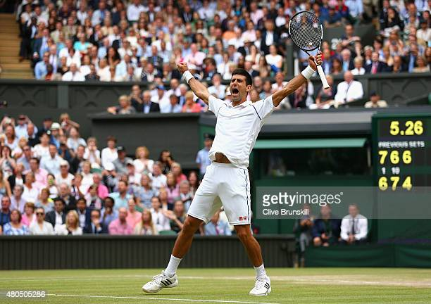 Novak Djokovic of Serbia celebrates after winning the Final Of The Gentlemen's Singles against Roger Federer of Switzerland on day thirteen of the...
