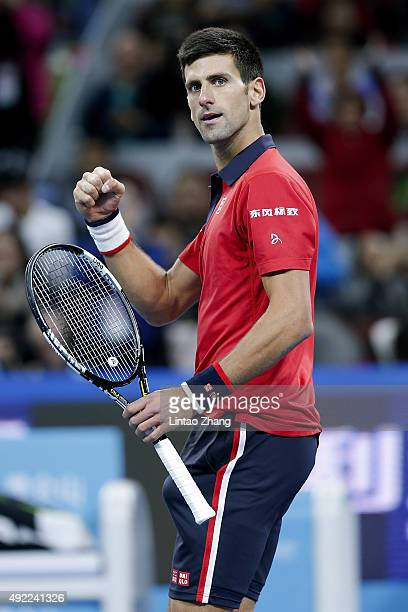 Novak Djokovic of Serbia celebrates after winning the Men's Single Final match against Rafael Nadal of Spain on day 9 of the 2015 China Open at the...