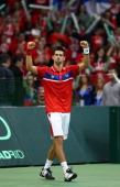 Novak Djokovic of Serbia celebrates defeating Gilles Simon of France during day one of the Davis Cup Tennis Final at the Begrade Arena on December 3...