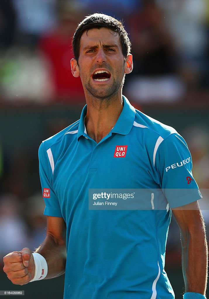 Novak Djokovic of Serbia celebrates defeating Jo-Wilfried Tsonga of France during day twelve of the BNP Paribas Open at Indian Wells Tennis Garden on March 18, 2016 in Indian Wells, California.