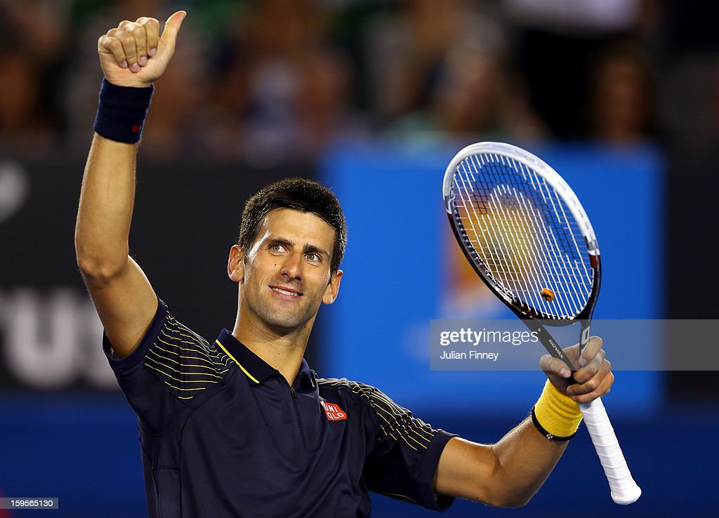 Novak Djokovic of Serbia celebrates defeating Ryan Harrison of USA in his second round match during day three of the 2013 Australian Open at Melbourne Park on January 16, 2013 in Melbourne, Australia.