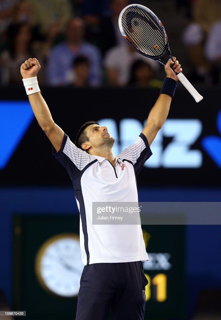 Novak Djokovic of Serbia celebrates defeating Tomas Berdych of Czech Republic in the Quarterfinal match during day nine of the 2013 Australian Open at Melbourne Park on January 22, 2013 in Melbourne, Australia.
