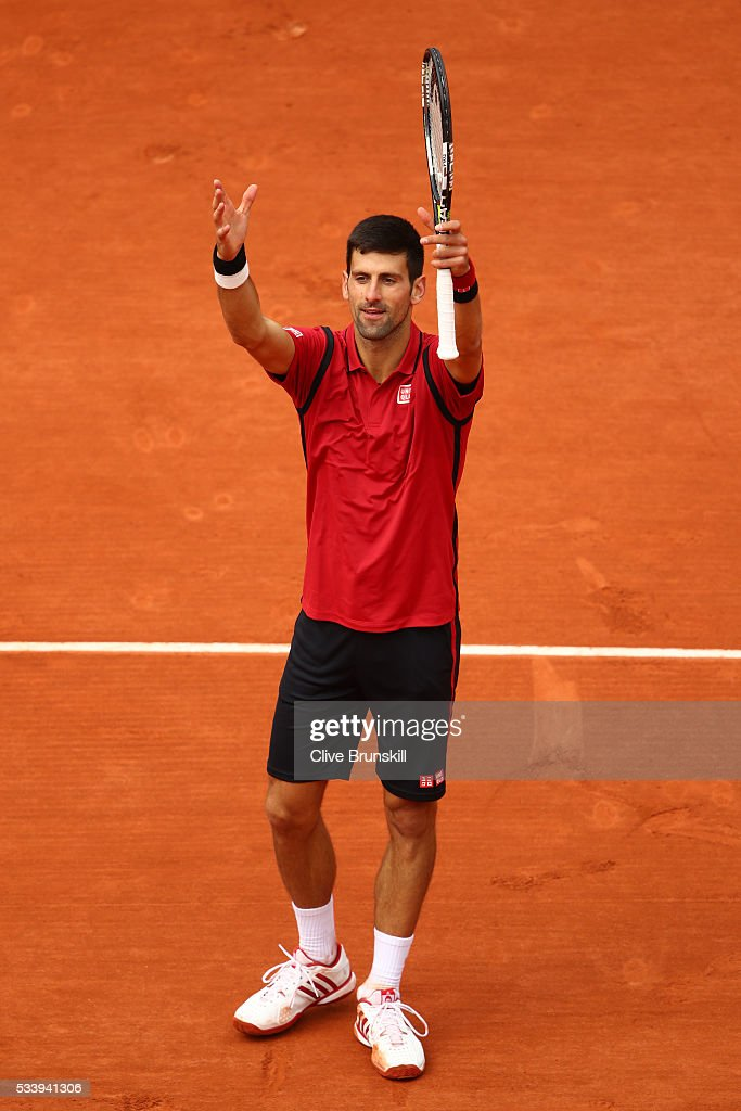 <a gi-track='captionPersonalityLinkClicked' href=/galleries/search?phrase=Novak+Djokovic&family=editorial&specificpeople=588315 ng-click='$event.stopPropagation()'>Novak Djokovic</a> of Serbia celebrates following victory during the Men's Singles first round match against Yen-Hsun Lu of Taipei on day three of the 2016 French Open at Roland Garros on May 24, 2016 in Paris, France.