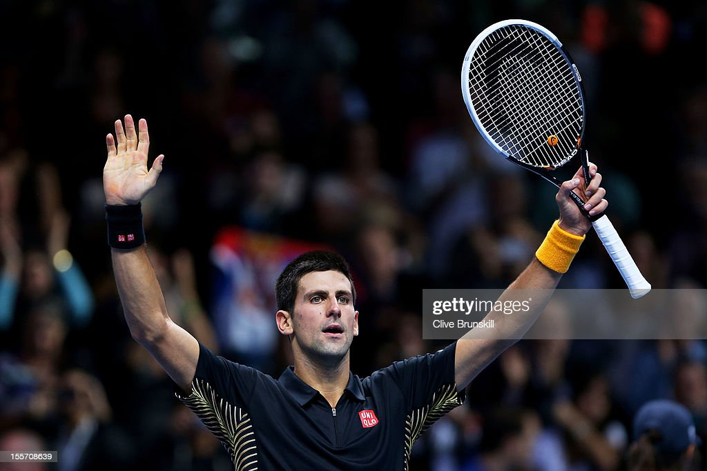 <a gi-track='captionPersonalityLinkClicked' href=/galleries/search?phrase=Novak+Djokovic&family=editorial&specificpeople=588315 ng-click='$event.stopPropagation()'>Novak Djokovic</a> of Serbia celebrates his victory during the men's singles match against Andy Murray of Great Britain on day three of the ATP World Tour Finals at the at O2 Arena on November 7, 2012 in London, England.