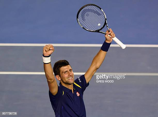 TOPSHOT Novak Djokovic of Serbia celebrates his victory over Andy Murray of Britain in their men's singles final match on day 14 of the 2016...