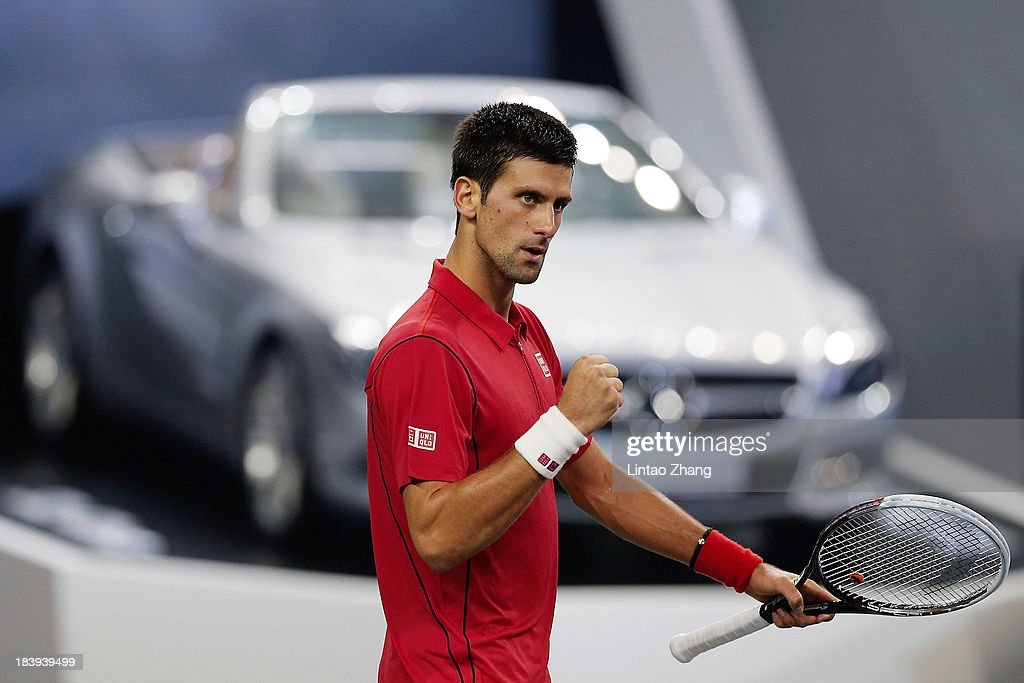<a gi-track='captionPersonalityLinkClicked' href=/galleries/search?phrase=Novak+Djokovic&family=editorial&specificpeople=588315 ng-click='$event.stopPropagation()'>Novak Djokovic</a> of Serbia celebrates his win against Fabio Fognini of Italy during the Shanghai Rolex Masters at the Qi Zhong Tennis Center on October 10, 2013 in Shanghai, China.