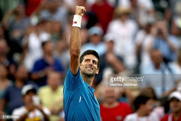 Novak Djokovic of Serbia celebrates his win over Dominic Thiem of Austria during the Miami Open presented by Itau at Crandon Park Tennis Center on...