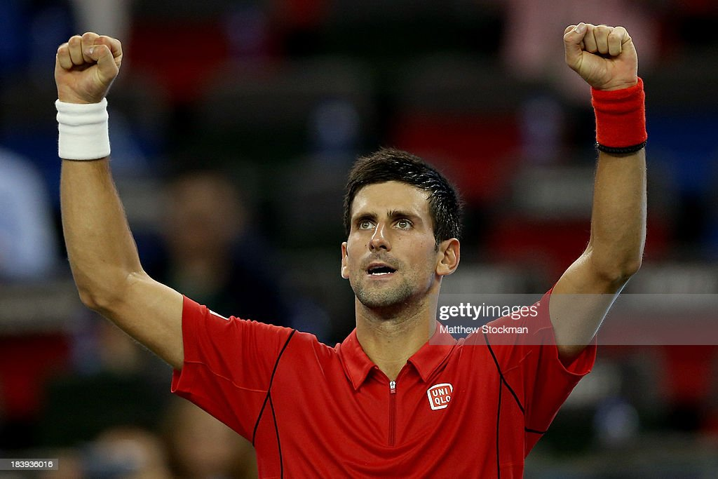 <a gi-track='captionPersonalityLinkClicked' href=/galleries/search?phrase=Novak+Djokovic&family=editorial&specificpeople=588315 ng-click='$event.stopPropagation()'>Novak Djokovic</a> of Serbia celebrates his win over Fabio Fognini of Italy during the Shanghai Rolex Masters at the Qi Zhong Tennis Center on October 10, 2013 in Shanghai, China.