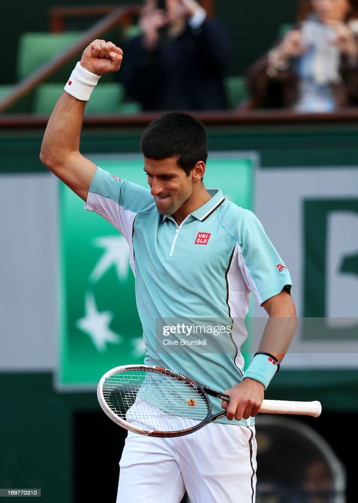 Novak Djokovic of Serbia celebrates match point during his Men's Singles match against Grigor Dimitrov of Bulgaria on day seven of the French Open at Roland Garros on June 1, 2013 in Paris, France.