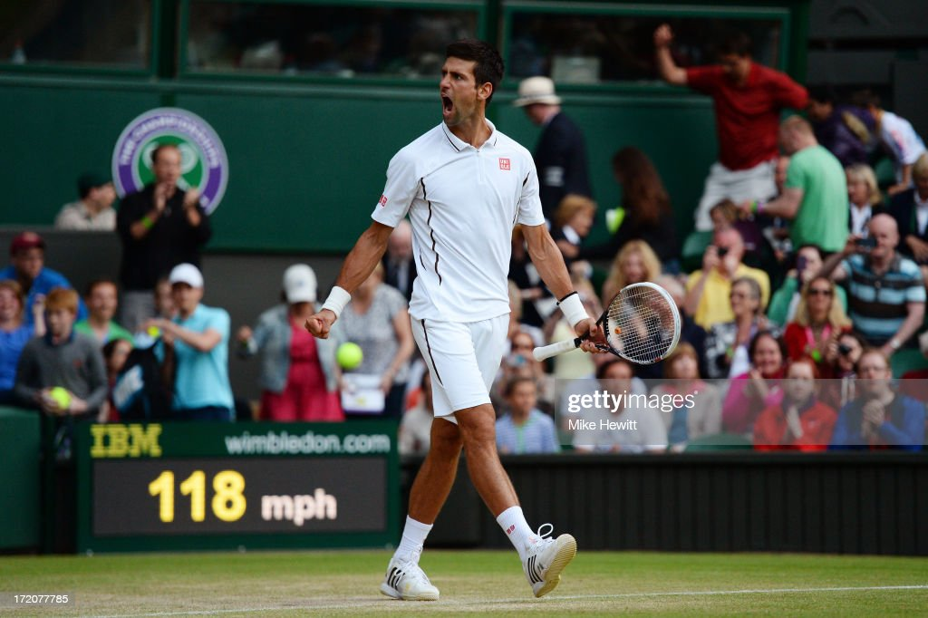 Novak Djokovic of Serbia celebrates match point during the Gentlemen's Singles fourth round match against Tommy Haas of Germany on day seven of the Wimbledon Lawn Tennis Championships at the All England Lawn Tennis and Croquet Club on July 1, 2013 in London, England.
