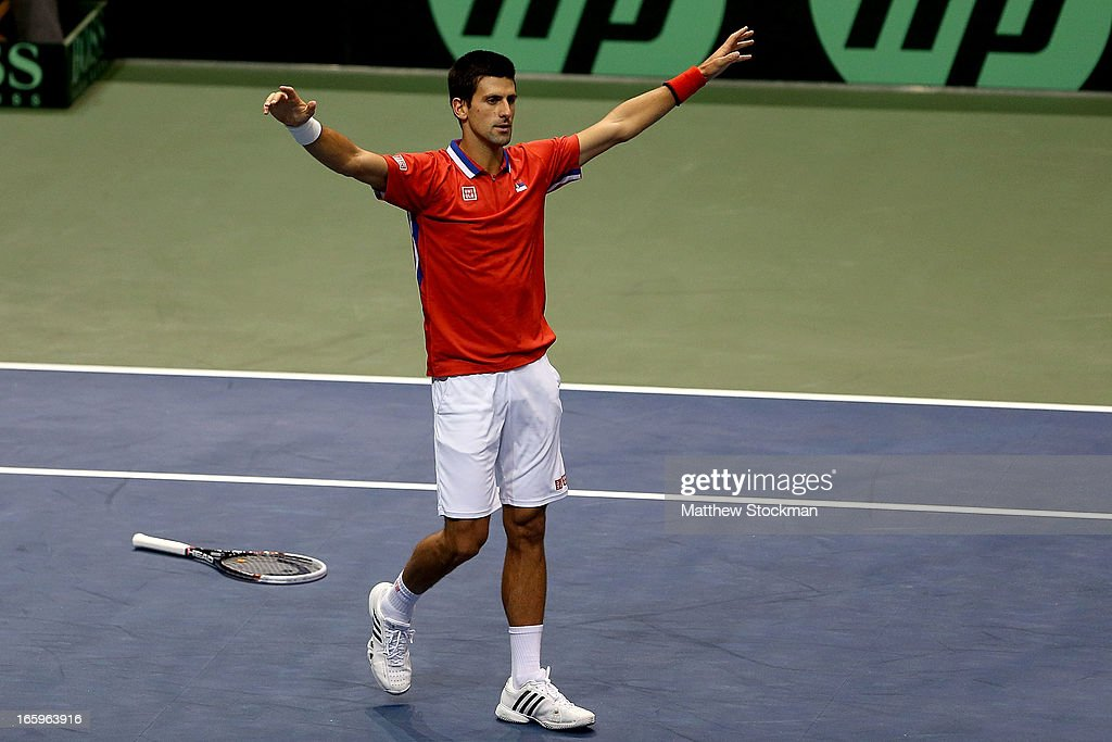 <a gi-track='captionPersonalityLinkClicked' href=/galleries/search?phrase=Novak+Djokovic&family=editorial&specificpeople=588315 ng-click='$event.stopPropagation()'>Novak Djokovic</a> of Serbia celebrates match point in the fourth rubber against Sam Querrey during the Davis Cup tie between the United States and Serbia at Taco Bell Arena on April 7, 2013 in Boise, Idaho.