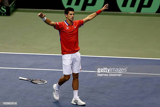 Novak Djokovic of Serbia celebrates match point in the fourth rubber against Sam Querrey during the Davis Cup tie between the United States and...
