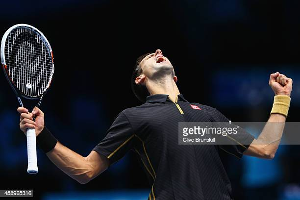 Novak Djokovic of Serbia celebrates match point in the round robin singles match against Tomas Berdych of Czech Republic on day six of the Barclays...