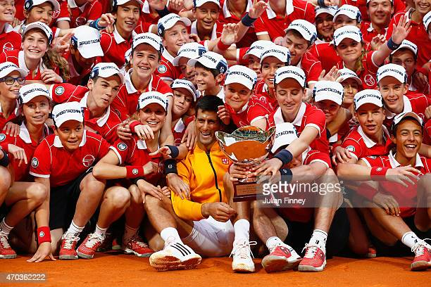 Novak Djokovic of Serbia celebrates the ball boys and girls with the winners trophy after defeating Tomas Berdych of Czech Republic in the final...
