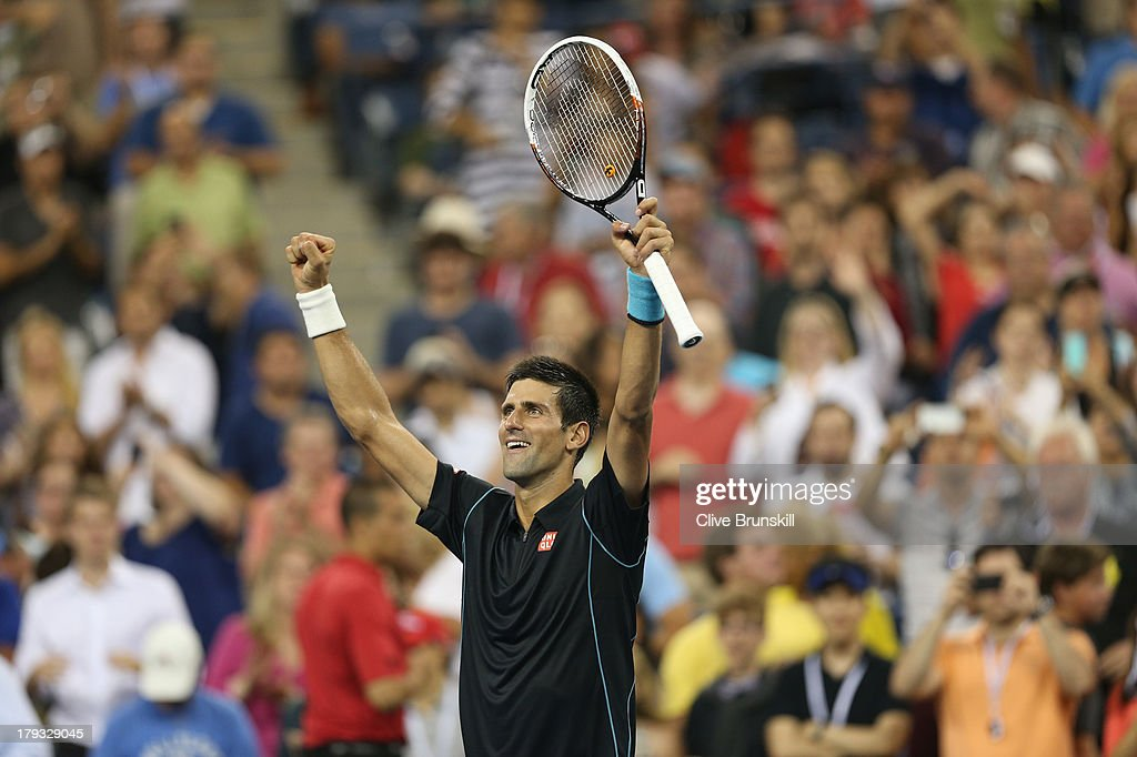 <a gi-track='captionPersonalityLinkClicked' href=/galleries/search?phrase=Novak+Djokovic&family=editorial&specificpeople=588315 ng-click='$event.stopPropagation()'>Novak Djokovic</a> of Serbia celebrates to the crowd after his straight sets victory against Joao Sousa of Portugal during the third round match on Day Seven of the 2013 US Open at USTA Billie Jean King National Tennis Center on September 1, 2013 in the Flushing neighborhood of the Queens borough of New York City.