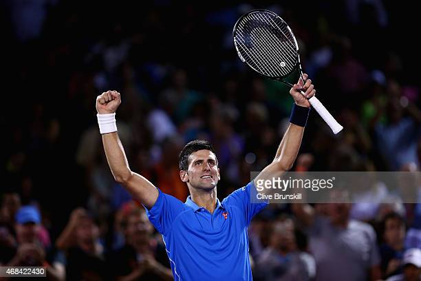 Novak Djokovic of Serbia celebrates to the crowd after his straight sets victory against David Ferrer of Spain in their quarter final during the...