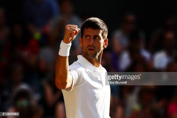 Novak Djokovic of Serbia celebrates victory after the Gentlemen's Singles third round match against Ernests Gulbis of Latvia on day six of the...