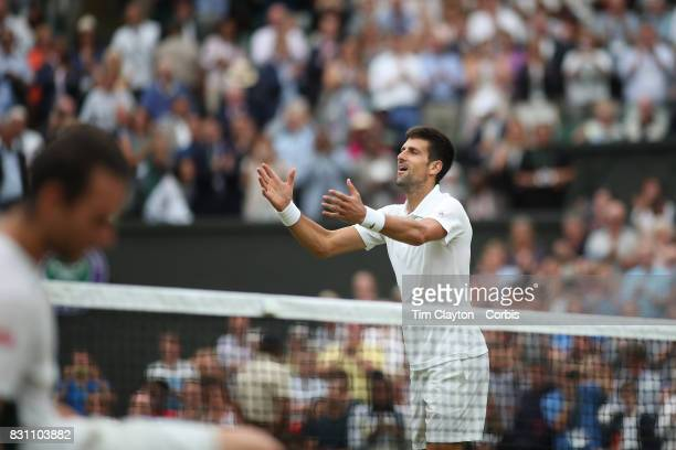 Novak Djokovic of Serbia celebrates victory against Adrian Mannarino of France in the Gentlemen's Singles round of sixteen at the Wimbledon Lawn...